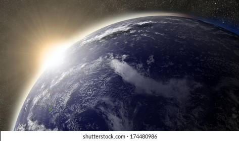 Sunset over Pacific ocean on planet Earth viewed from space with Moon and stars in the background. Elements of this image furnished by NASA.