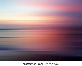 Sunset over the sea. Blurry beach landscape background at dusk. Colorful soft pink sunset sunrise view. Abstract nature backdrop for holiday and Inspiration inspirational backgrounds.