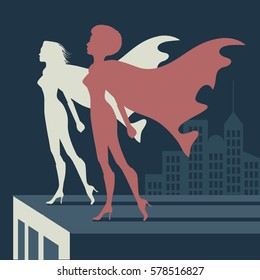 Superwomen atop a skyscraper. Two female super heroes standing strong together in a cityscape.