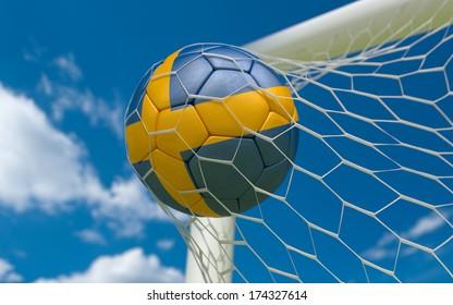 Sweden flag and soccer ball, football in goal net