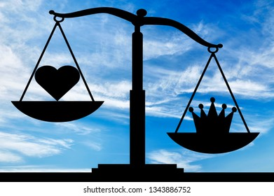 Symbol crown selfishness in priority over the symbol of the heart altruism on the scales. The concept of the predominance of egoism in society