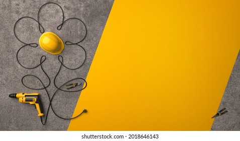 A symbolic flower made of a drill wire and a protective helmet on a gray concrete background. A greeting card for the Builder's Day, Labor Day or a similar professional holiday. 3D render.
