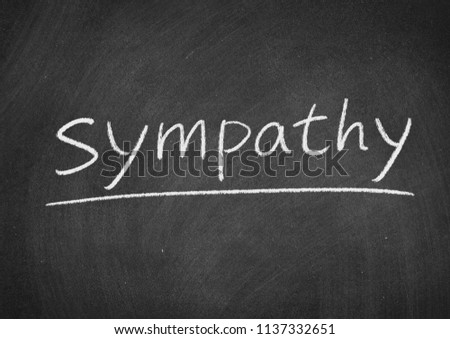 sympathy concept word on a blackboard background