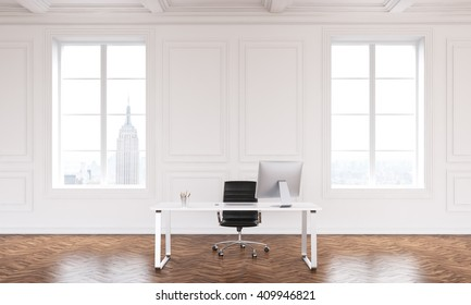 Table with computer in big hall, two windows, luxury parquet. Concept of new office. Mock up. 3D rendering