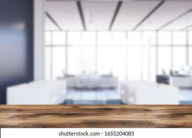 Table for your product in blurry office waiting room with blue walls and floor and comfortable white armchairs. Concept of advertising. 3d rendering