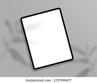Tablet with empty screen. Tablet mockup on minimal background. Modern tablet display mockup scene. Top view. Photo mockup with clipping path.