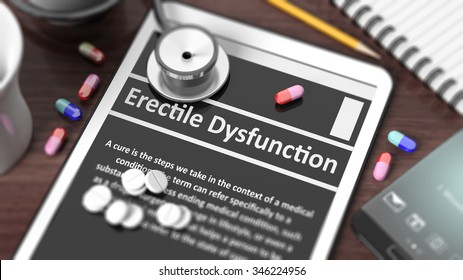 """Tablet with """"Erectile Dysfunction"""" on screen, stethoscope, pills and objects on wooden desktop."""