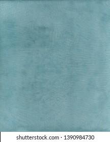 Tadelakt sample, lime plaster ecologic and natural. Turquoise texture background