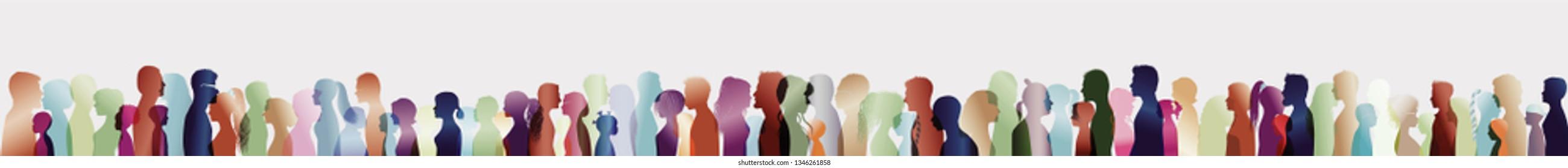 Talking crowd. Large group of people. Dialogue between people. Silhouette profiles. People talking. Blue multiple exposure