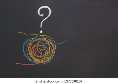 A tangled tangle painted under the flag of Venezuela drawn on a chalk board. The concept of disentangling problems.