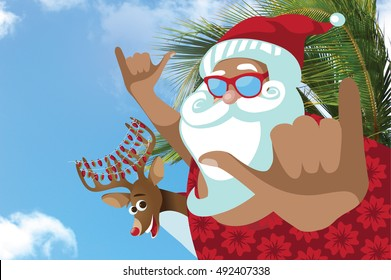 Tanned cartoon Santa Claus in a Hawaiian shirt giving the Shaka sign in a tropical location with his reindeer.