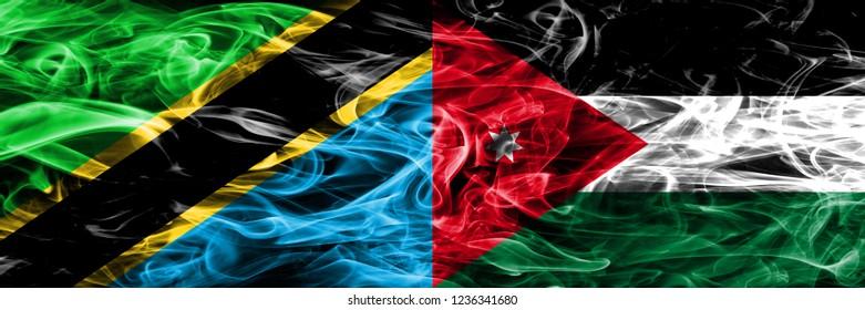 Tanzania vs Jordan, Jordanian smoke flags placed side by side. Thick colored silky smoke flags of Tanzanian and Jordan, Jordanian