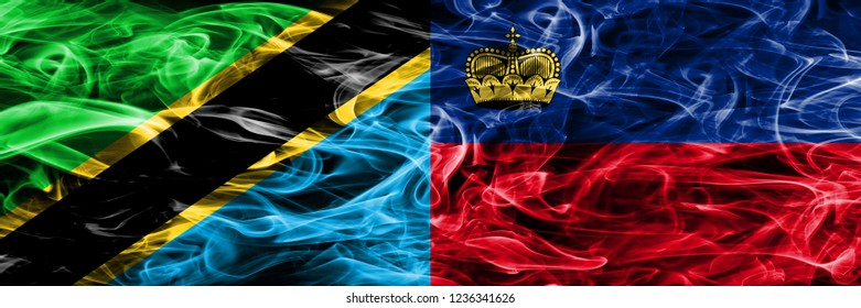 Tanzania vs Liechtenstein, Liechtensteins smoke flags placed side by side. Thick colored silky smoke flags of Tanzanian and Liechtenstein, Liechtensteins
