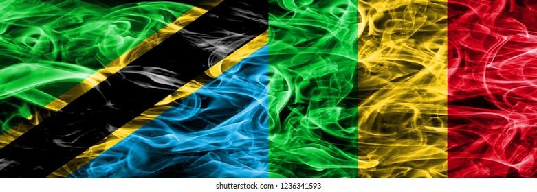 Tanzania vs Mali smoke flags placed side by side. Thick colored silky smoke flags of Tanzanian and Mali