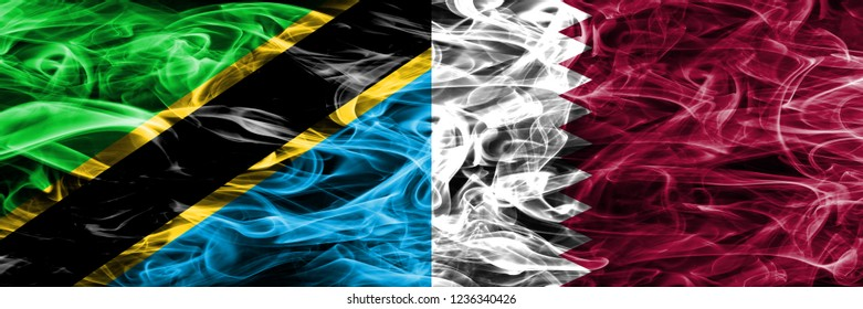 Tanzania vs Qatar, Qatari smoke flags placed side by side. Thick colored silky smoke flags of Tanzanian and Qatar, Qatari