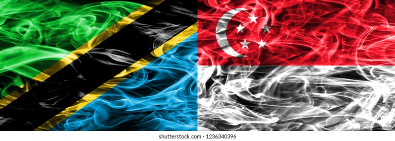 Tanzania vs Singapore, Singaporean smoke flags placed side by side. Thick colored silky smoke flags of Tanzanian and Singapore, Singaporean
