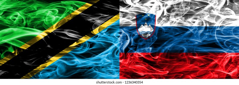 Tanzania vs Slovenia, Slovenian smoke flags placed side by side. Thick colored silky smoke flags of Tanzanian and Slovenia, Slovenian