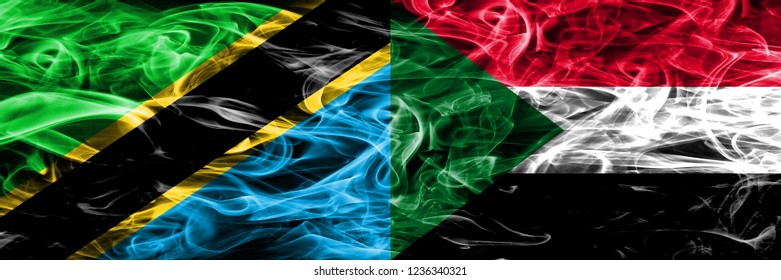 Tanzania vs Sudan, Sudanese smoke flags placed side by side. Thick colored silky smoke flags of Tanzanian and Sudan, Sudanese