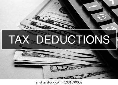 Tax Deductions Closeup Concept. Business. Tax Deductions text at Dollar Banknote.
