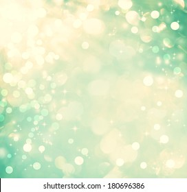 Teal colored abstract shiny light and glitter background