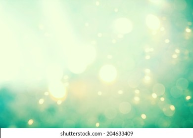 Teal colored abstract shiny light gradient background
