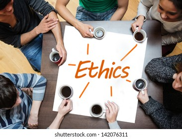Team brainstorming over a poster on a table with ethics written on it