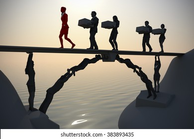 Team bridge made of people near the sea. A bridge next to the sea made of people, where a leader and the rest of the team executives carry items from one side to the other.
