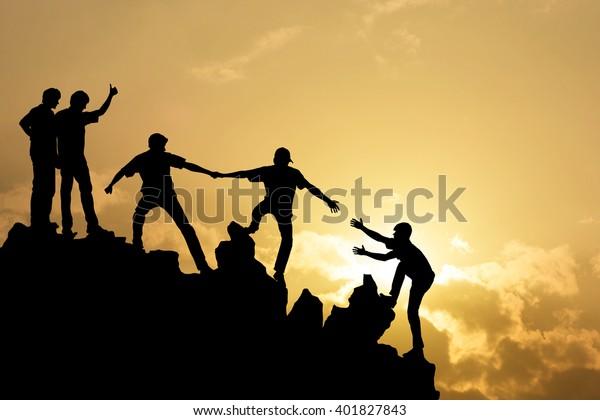 Team of people work on peak mountain  climbing helping teamwork , success business concept