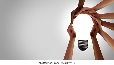Team thinking together as a diverse group of people coming together joining hands into the shape of an inspirational light bulb 3D elements.