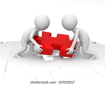 Teamwork/Two people are moving a piece of the puzzle