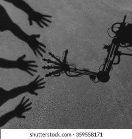 Technology and society concept as a shadow of reaching people hands interacting greeting an advanced computer aided robot arm as a work assistant symbol and artificial intelligence social issue.