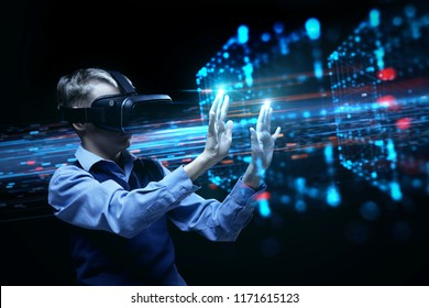 A teenager boy interacts with virtual reality. VR-technology and wearable tech concept. A teenager boy wearing VR-glasses.Boy wearing virtual reality headset with technology background