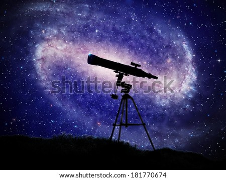 A telescope with a large spiral galaxy in the background