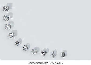 Ten diamonds of the most popular cut styles arced along the image corner . Top view with shadows and caustics rays on white background. 3D rendering illustration