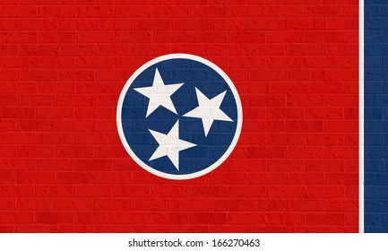 Tennessee state flag of America on brick wall, isolated on white background.