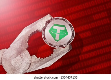 Tether (USDT) coin is under pressure. Concept of the regulation or control of tether cryptocurrency; limitation; prohibition