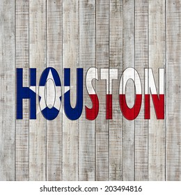 Texas flag with Houston text and wood background