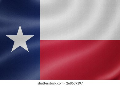 Texas flag on the fabric texture background
