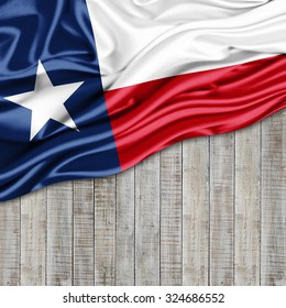 texas  flag of silk with copyspace for your text or images and wood background
