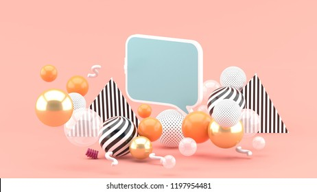 A text box among colorful balls on a pink background.-3d rendering.