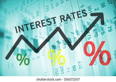 Text Interest rates on up trend arrow, with financial data visible on the background.