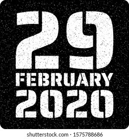 Text of leap day 29 February 2020 in white text on a black background, the added effects give the illustration a stamp like effect.