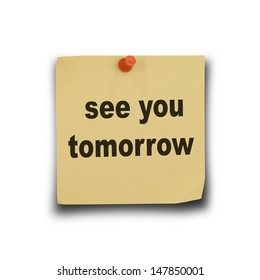 text see you tomorrow on note paper and pin on white background