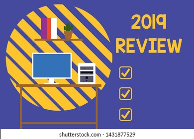Text sign showing 2019 Review. Conceptual photo New trends and prospects in tourism or services for 2019 Desktop computer wooden table background shelf books flower pot ornaments.