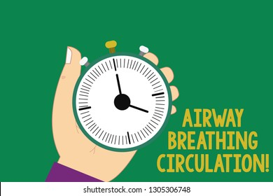 Text sign showing Airway Breathing Circulation. Conceptual photo Memory aid for rescuers performing CPR Hu analysis Hand Holding Mechanical Stop Watch Timer with Start Stop Button.