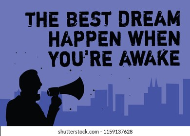 Text sign showing The Best Dream Happen When You re are Awake. Conceptual photo Dreams come true Have to believe Man holding megaphone speaking politician making promises blue background.
