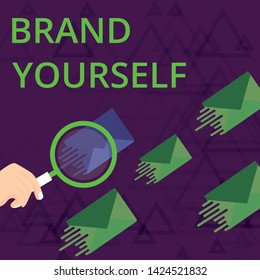 Text sign showing Brand Yourself. Conceptual photo Develop a unique professional identity Personal product Magnifying Glass on One Different Color Envelope and others has Same Shade.