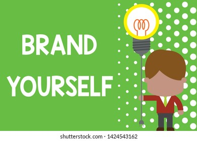 Text sign showing Brand Yourself. Conceptual photo Develop a unique professional identity Personal product Standing man tie holding plug socket light bulb to connect idea. Startup.