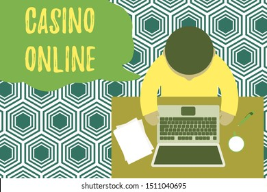 Text sign showing Casino Online. Conceptual photo Computer Poker Game Gamble Royal Bet Lotto High Stakes Upper view young man sitting working table laptop documents coffee cup pen.