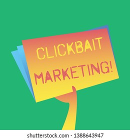 Text sign showing Clickbait Marketing. Conceptual photo Online content that aim to generate page views Hand Holding and Raising Blank Space Colorful File Folder with Sheet Inside.